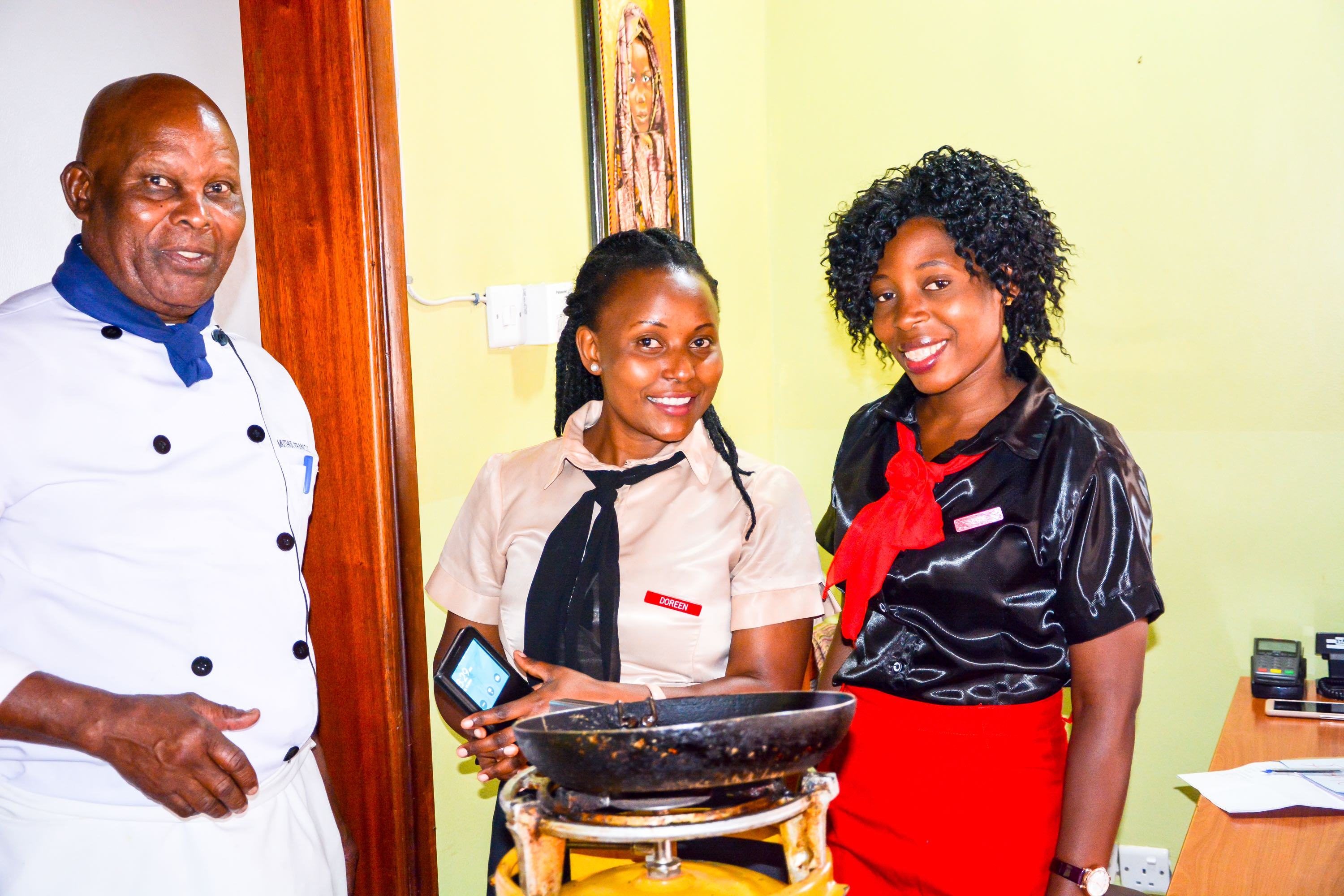 Chef Francis at Adonai Guesthouse in Muyenga along with Doreen and Loy